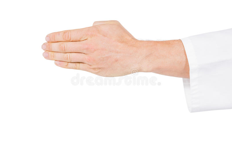 Karate player making hand gesture on white background. Close-up of karate player making hand gesture on white background stock photo