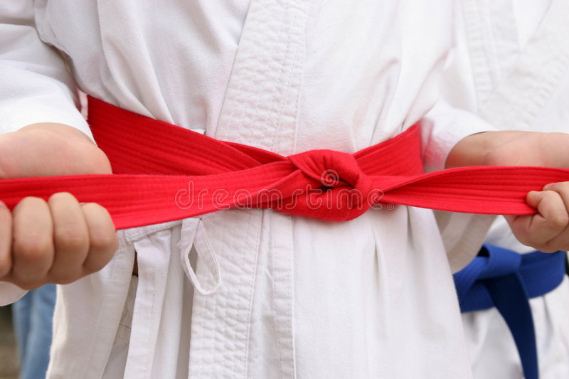 Karate red belt. In closeup royalty free stock photography