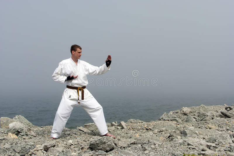 Karate on the shores of the sea stock image