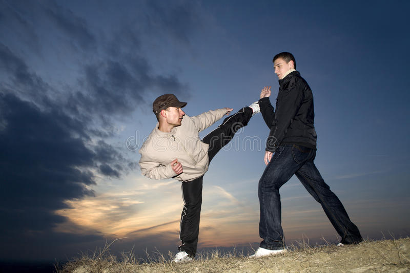 Karate training in evening stock images