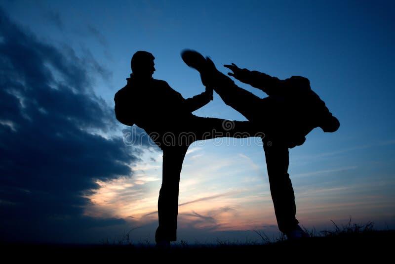 Karate training in evening stock image
