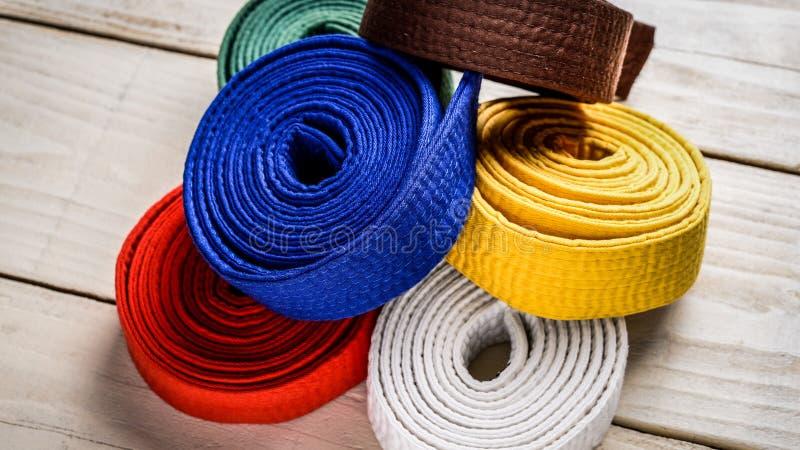 Karatebälten royaltyfria foton