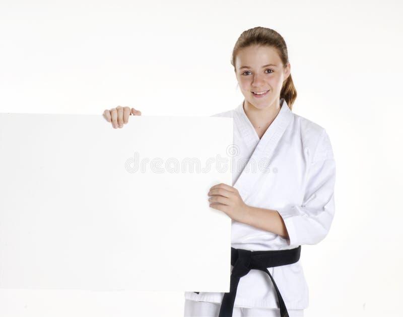 Karateflicka. royaltyfri foto