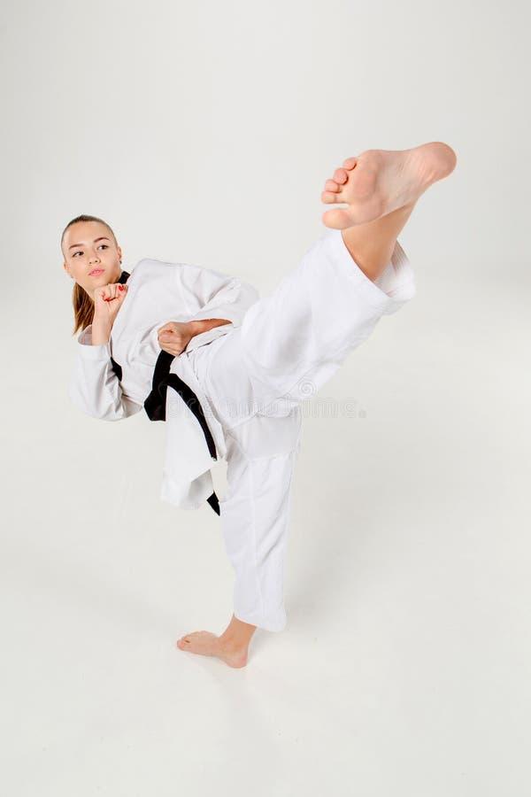 Karateflickan med det svarta bältet arkivfoton