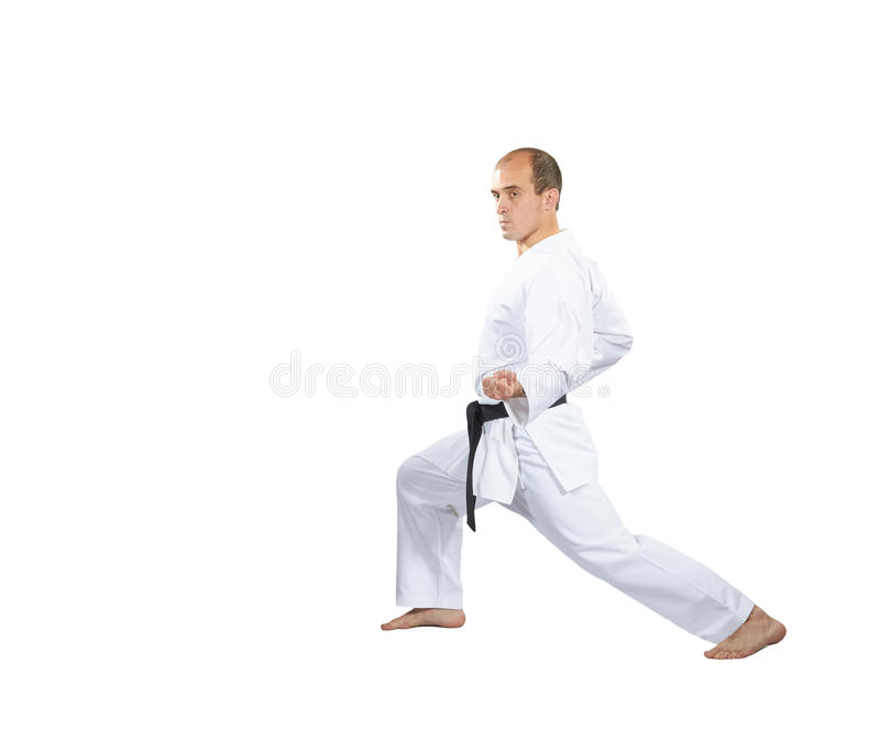 In karategi, maakt een mens een blok met zijn hand stock afbeelding