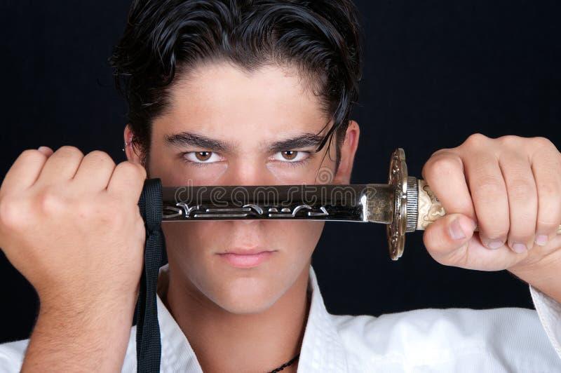 Karateman med katana royaltyfria bilder