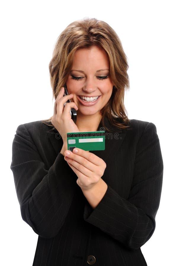 karciany komórki kredyta telefon używać kobiety zdjęcie royalty free