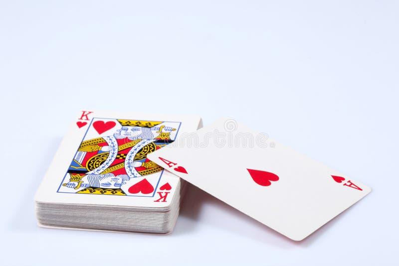 Karciany pokład z serca as i królewiątko na odgórny odosobnionym na białym tle z kopii przestrzenią zdjęcie royalty free