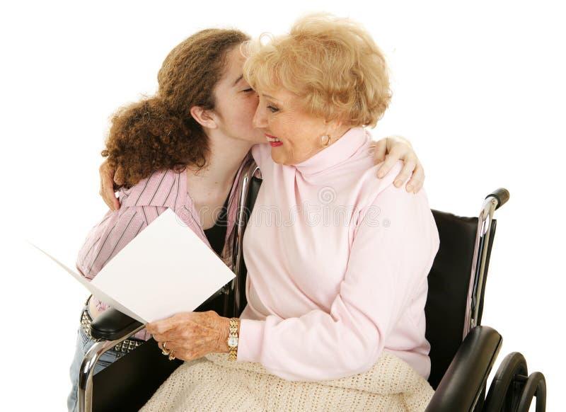 Kardieren Sie u. küssen Sie für Großmutter stockfoto