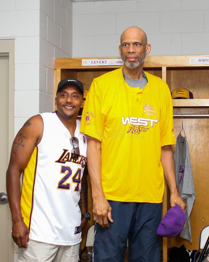 Kareem Abdul-Jabbar. Laker's legend Kareem Abdul-Jabbar poses with a fan at a celebrity softball game royalty free stock photo