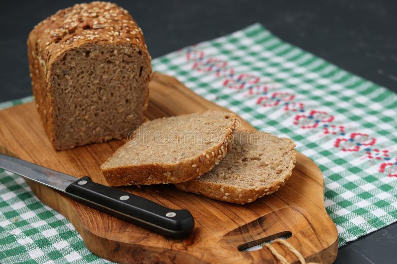 Karelian bread made from whole grain flour. Located on a wooden board on dark background stock images