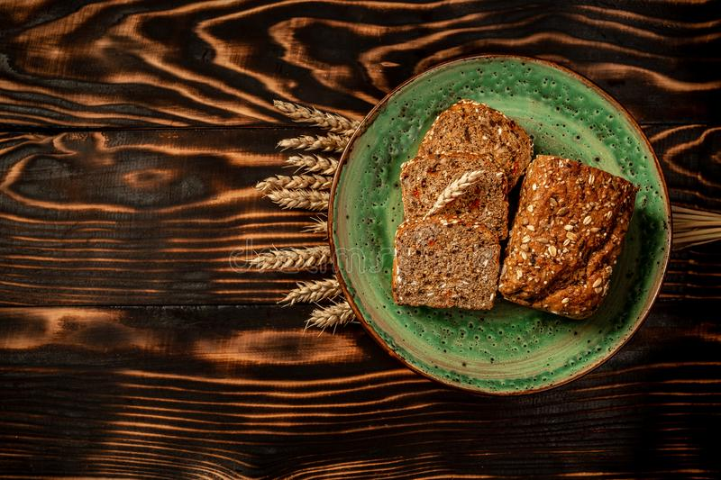 Karelian bread made from whole grain flour located and ears of rye or wheat grain. top view, space for text.  stock image