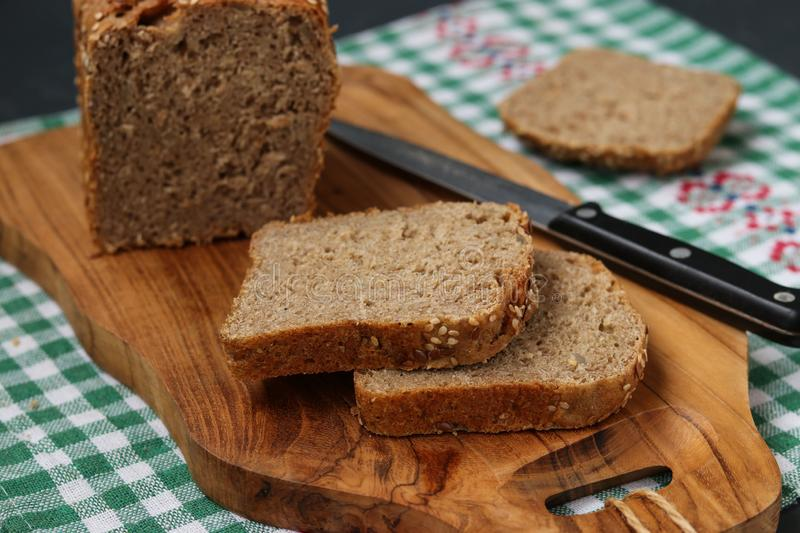 Karelian bread made from whole grain flour. Located on a wooden board on dark background stock photo