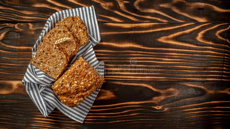 Karelian bread made from whole grain flour located on a wooden board. top view, space for text.  stock photography