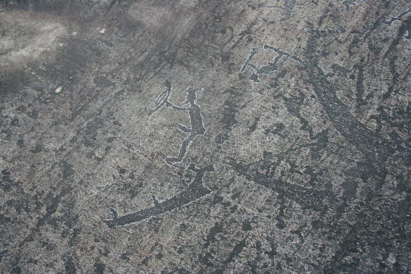 Karelische rotstekeningen Rotsschilderijen stock afbeeldingen