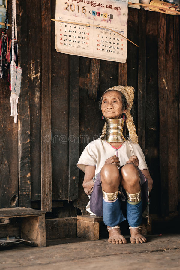 Karen Long Neck woman from hill tribe village in Myanmar. Pan Pet, Myanmar - May 25, 2016: Portrait of Padaung (Karen) long neck woman in brass rings around stock images
