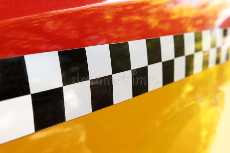 Kariertes gelbes Taxi Abstrakter Hintergrund stockbilder