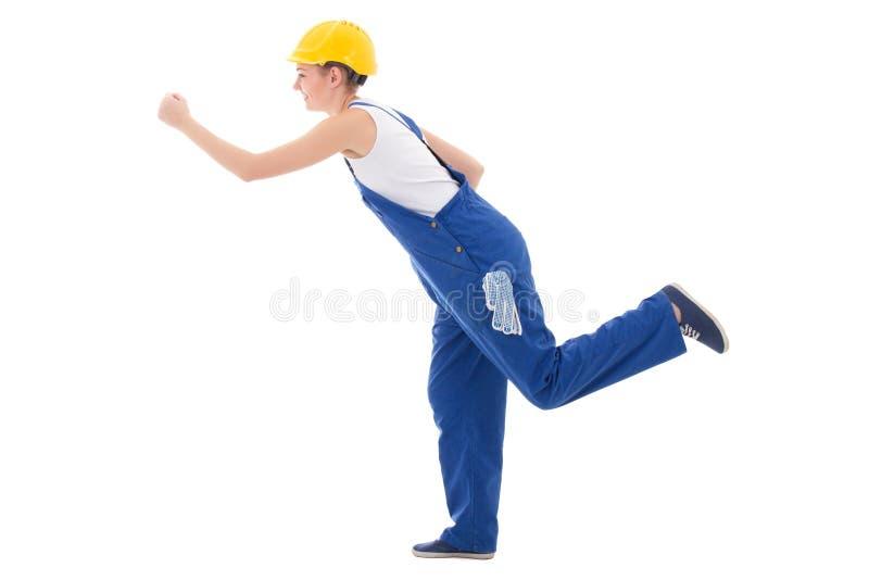 Kariery pojęcie - szczęśliwy kobieta budowniczy biega i w błękitnych coveralls fotografia royalty free