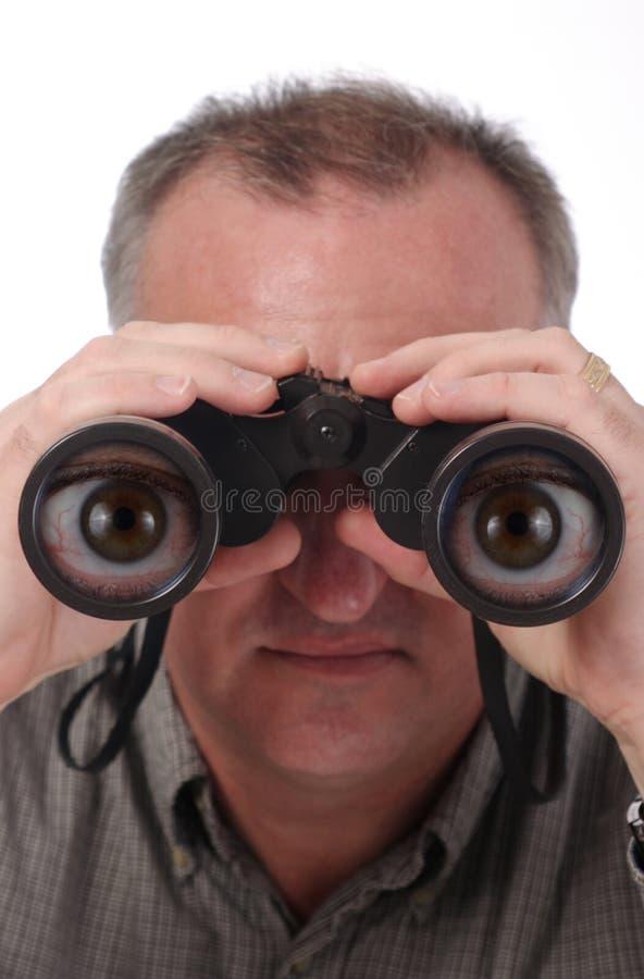 Karikatur-Augen in den Binokeln stockbilder