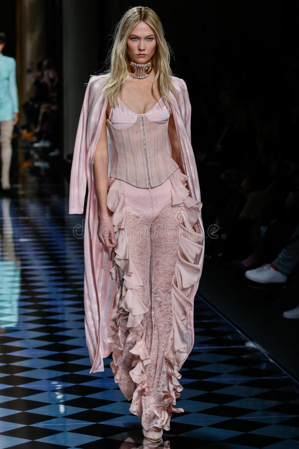 Karlie Kloss walks the runway during the Balmain show. PARIS, FRANCE - MARCH 03: Karlie Kloss walks the runway during the Balmain show as part of the Paris royalty free stock photos