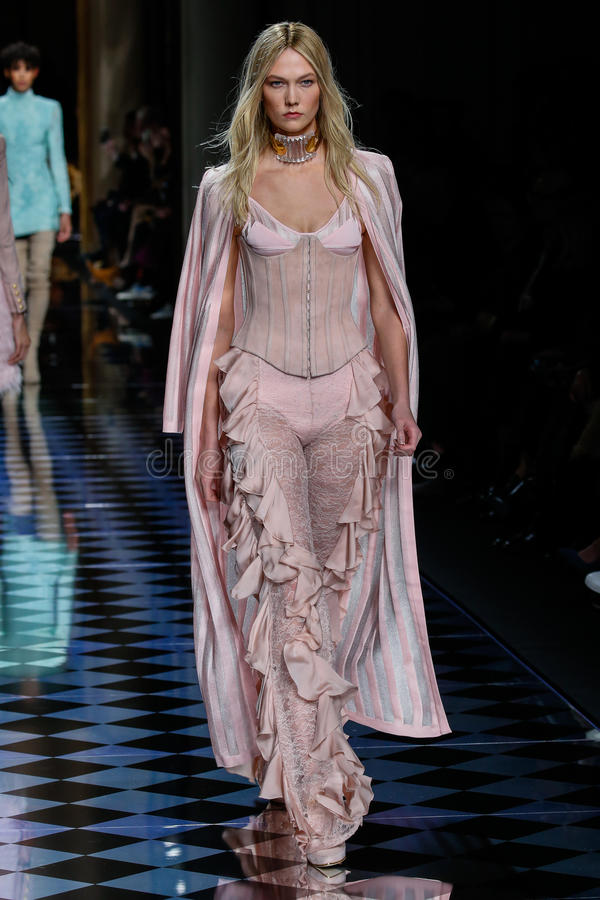 Karlie Kloss walks the runway during the Balmain show. PARIS, FRANCE - MARCH 03: Karlie Kloss walks the runway during the Balmain show as part of the Paris royalty free stock images