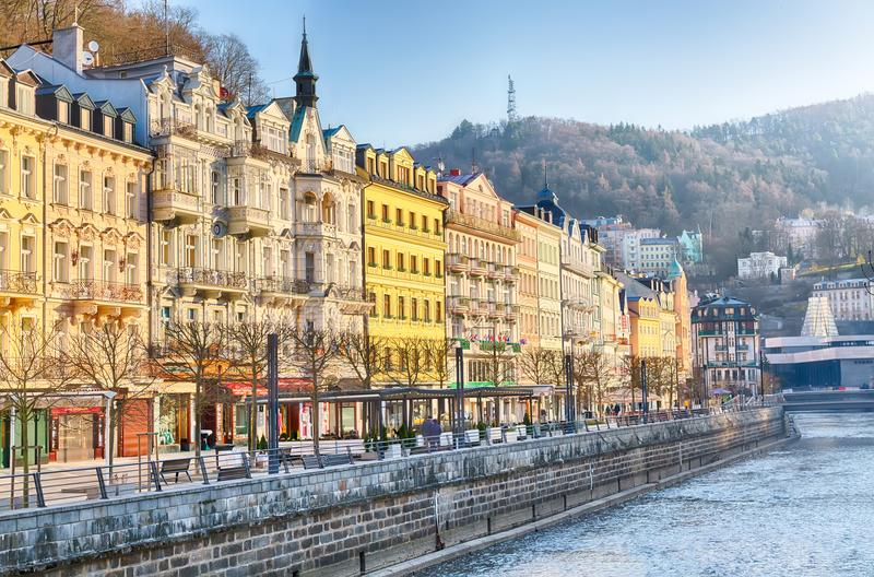 Karlovy Vary, Czech Republic - April, 2018: Houses in city center of Karlovy Vary on the Tepla river. Karlovy Vary Carlsbad is wor stock image