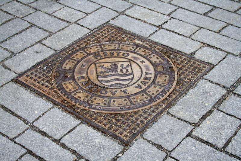 Karlovy Vary, Czech Republic, metal sewer cover. Sewer cover with an inscription in the city of Karlovy Vary in the Czech Republic royalty free stock photography