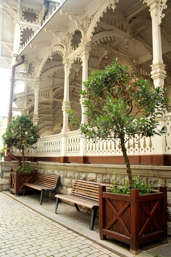 Karlovy Vary, Czech Republic - September 25, 2014: A rest place by the wooden Market Colonnade stock image