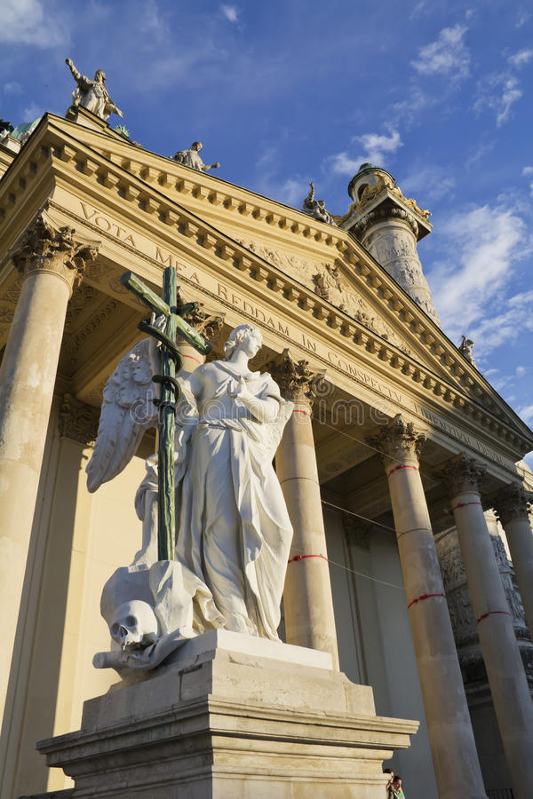 Karlskirche. Angel statue with cross in front of Karlskirche (St. Charles's Church), Vienna, Austria stock image