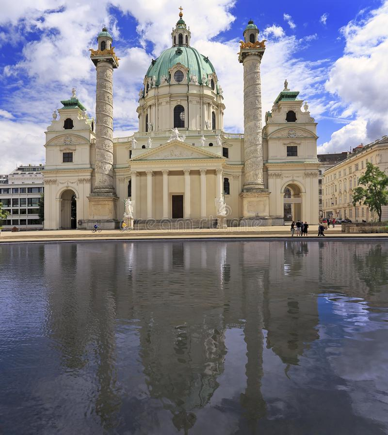 Karlskirche. St. Charles' Church with reflections into the water in Vienna, Austria stock images