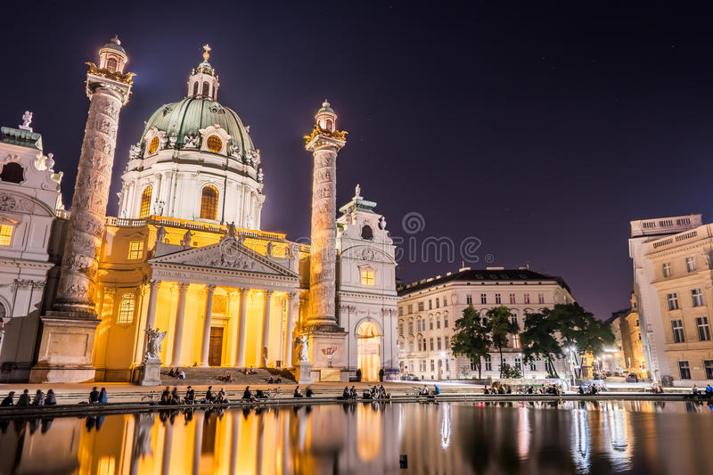 Karlskirche or St. Charles's Church. One of famous churches in Vienna, Austria. Beautiful night photography with illumination and reflection in the water stock images