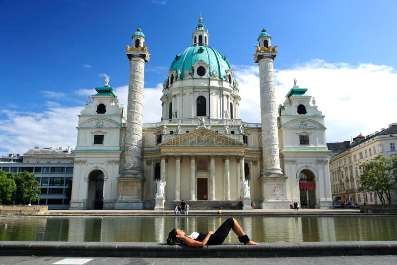 Karlskirche in Vienna. A woman meditating peacefully in front of The Karlskirche church,Vienna ,Austria stock image