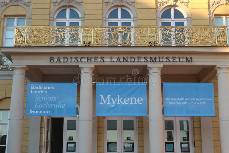 Karlsruhe, Germany, February 17th 2019, Entrance of the `Badisches Landesmuseum`. Featuring a banner for an exhibition on the Mycenaean civilization royalty free stock photos