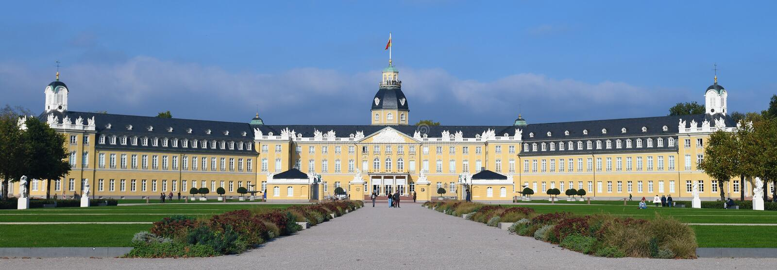 Karlsruhe, Germany - October 2019: Full view of front side of baroque Karlsruhe Palace with garden. On summer day royalty free stock image