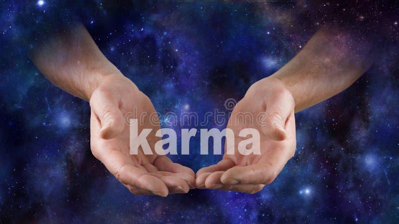 A karma cósmica está em suas mãos fotografia de stock