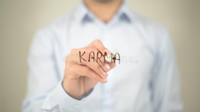 Karmas, escritura del hombre en la pared transparente fotografía de archivo