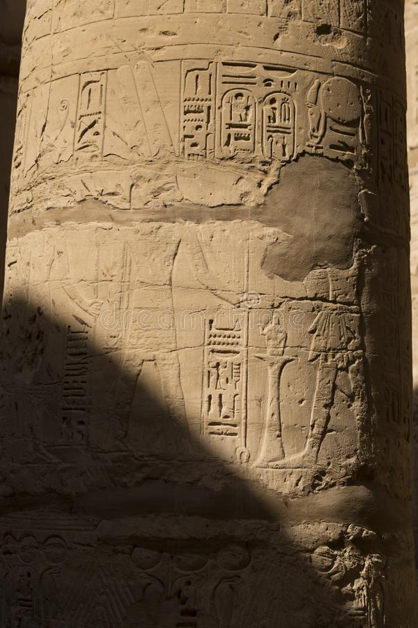 Karnak Temple, complex of Amun-Re. Embossed hieroglyphics on columns. Great Hypostyle Hall. Luxor Governorate, Egypt royalty free stock image
