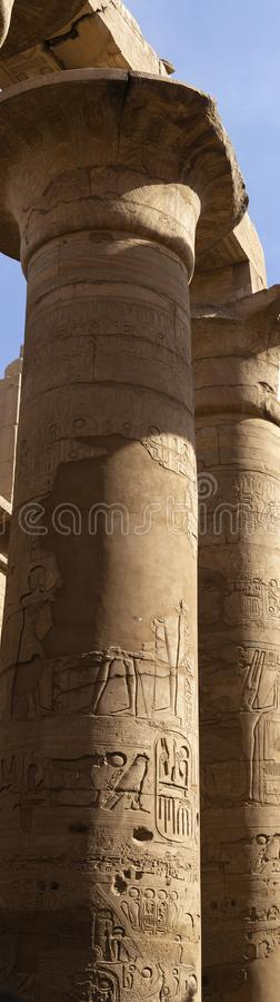 Karnak Temple, complex of Amun-Re. Embossed hieroglyphics on columns. Great Hypostyle Hall. Min  is an ancient Egyptian god. Luxor Governorate, Egypt royalty free stock photography