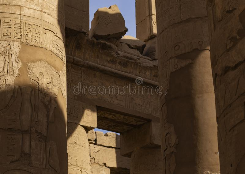 Karnak Temple, complex of Amun-Re. Great Hypostyle Hall. Embossed hieroglyphics on columns and walls. Luxor Governorate, Egypt stock images