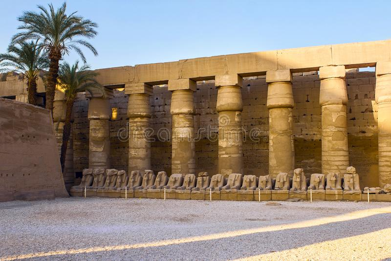 Karnak Temple, The ruins of the temple. Embossed hieroglyphs on the wall stock photography