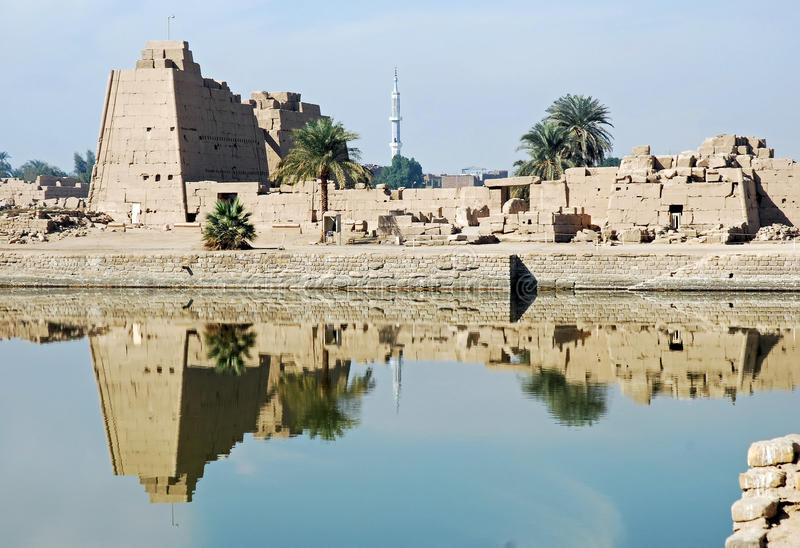 Karnak Temple ruins from the sacred lake, Luxor. View ruins Karnak temple, Luxor, Egypt with reflection in the sacred lake stock photos