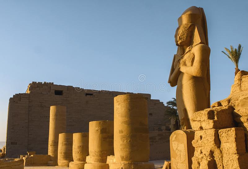 Karnak Temple, The ruins of the temple. Embossed hieroglyphs on the wall royalty free stock photography