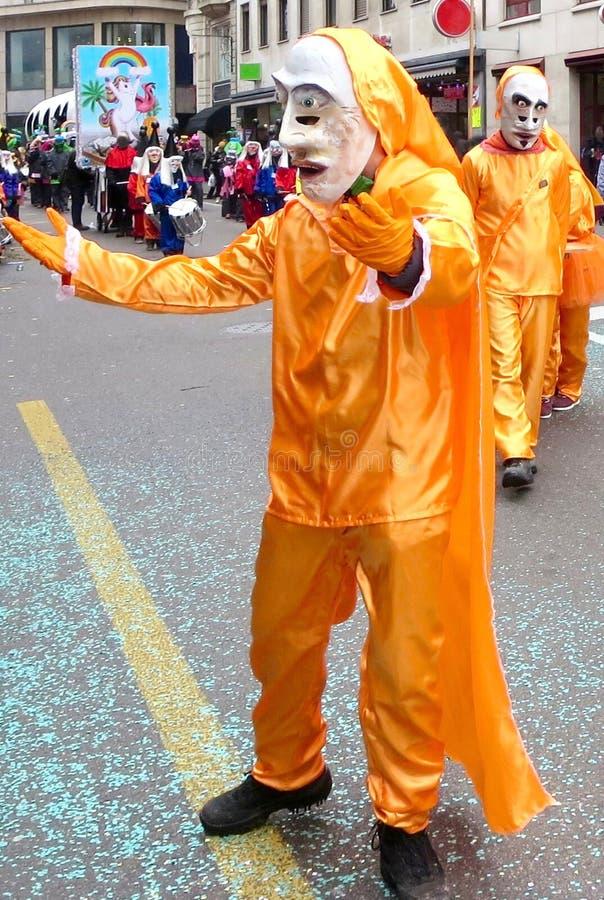 Karneval av Baseln - orange klänning royaltyfri bild