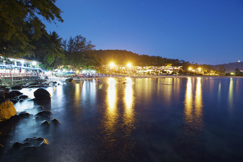 Karon beach at night time. Phuket island, Thailand. Long ( 98 sec ) exposure shot stock photography