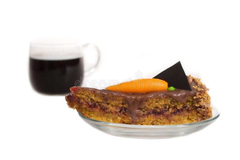 Karottekuchen mit cofee stockbild