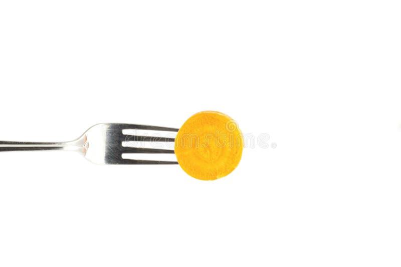 Karotten auf einer Gabel lizenzfreie stockfotos