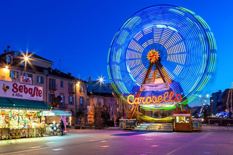 Karousel på torget i kväll i Alba, Italien fotografering för bildbyråer