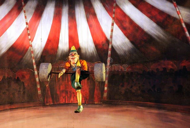 Karromato wooden circus at Bahrain, June 29, 2012. SANABIS, BAHRAIN - JUNE 29: Karromato Czech Marionette theater performs the act wooden circus during Bahrain royalty free stock image