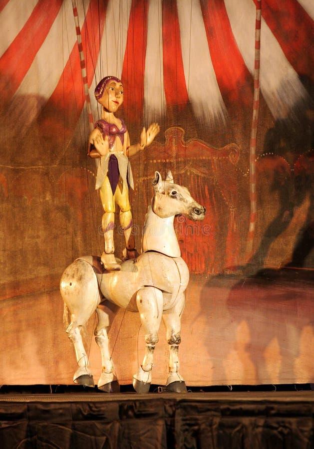 Karromato wooden circus at Bahrain, June 29, 2012. SANABIS, BAHRAIN - JUNE 29: Karromato Czech Marionette theater performs the act wooden circus during Bahrain royalty free stock images