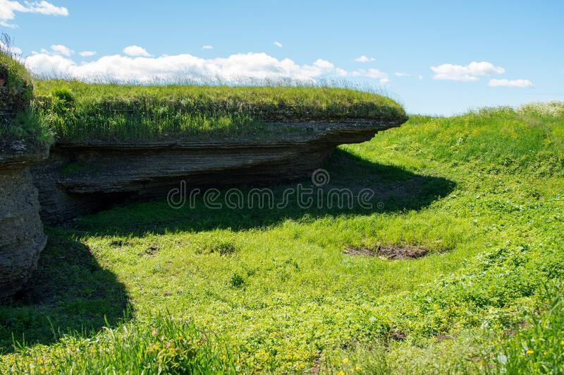 Karst limestone formations in estonia, near tallinn city. soil erosion and holes at the surface at kostivere area. Karst limestone formations in estonia, near stock photography